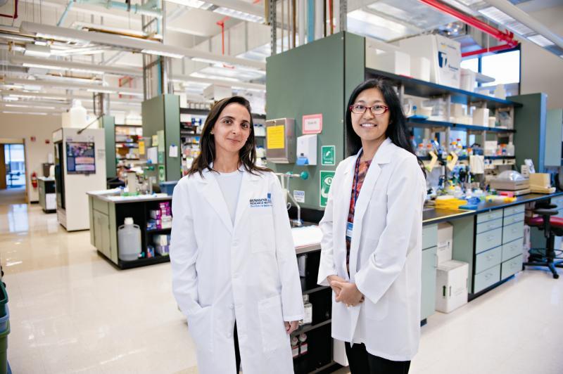 Dr. Estelle Bettelli (on left) and Dr. Mariko Kita in Bettelli's lab.