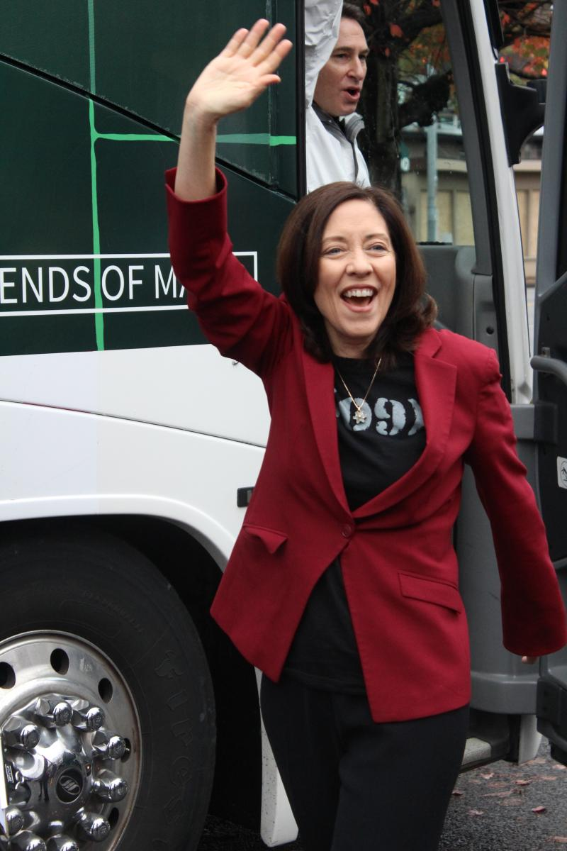 Senator Maria Cantwell waving at a campaign rally.