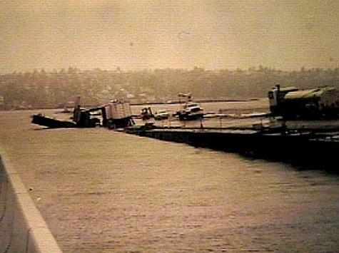 The Lacey V. Murrow Floating Bridge across Lake Washington lists and sinks while undergoing renovation in November 1990.  No one was hurt, but several construction vehicles sank along with the old concrete pontoons.
