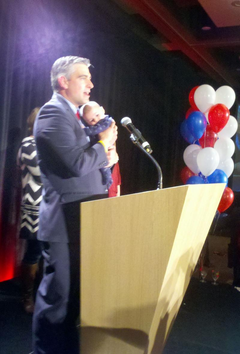 Michael Baumgartner and son Roman at the Washington State Republican Party's election night event in Bellevue.