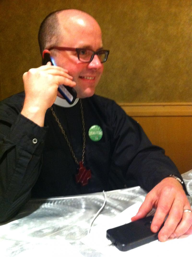 Rev. Stephen Crippen with St. Mark's Cathedral makes last minute phone-bank calls for the Approve Ref. 74 campaign at the Westin.