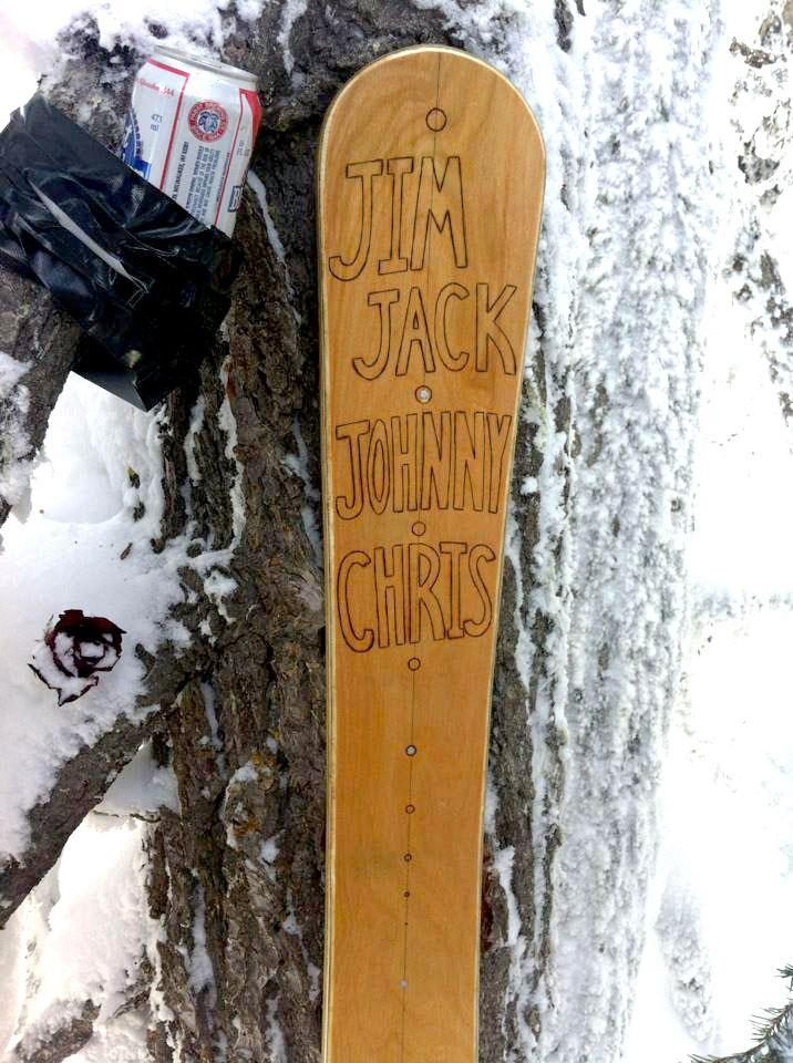A memorial ski displays the names of the three who died in February's avalanche near Stevens Pass.