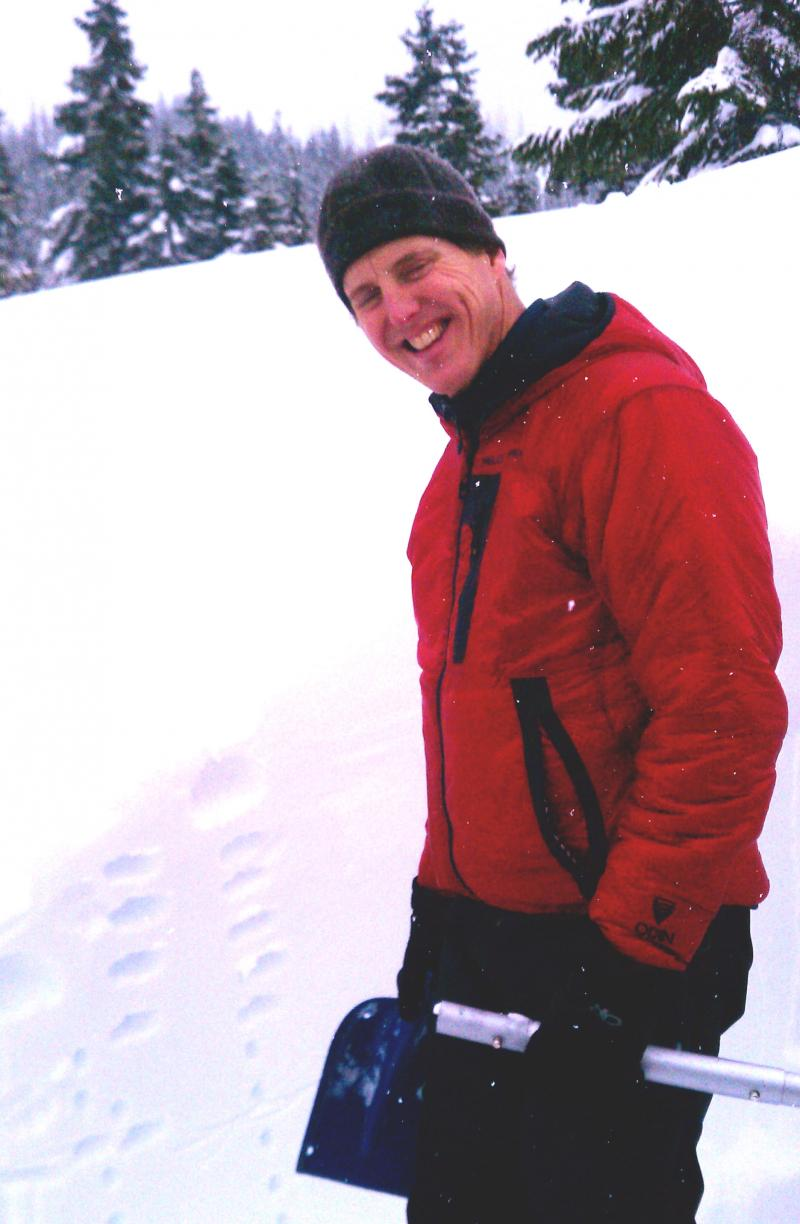 "Scott Schell teaching a three-day avalanche education course at Stevens Pass in March 2011. He's showing students how to dig a ""snow pit"" which helps them assess avalanche danger."