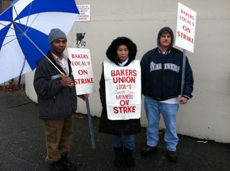 3 striking union members outside Hostess plant