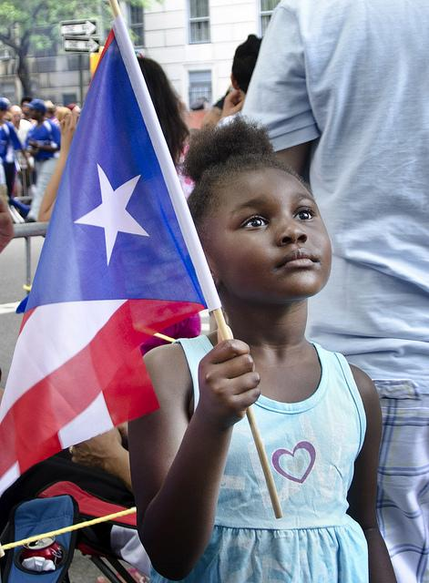 A little girl carries the Puerto Rican flag at the Puerto Rico Parade, New York City, June 2012.