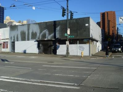 A new affordable apartment building is planned for this corner in Seattle's International District
