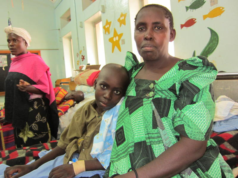 Mother and son in the children's ward at Uganda Cancer Institute in Kampala.