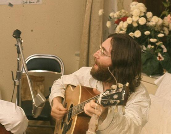 "John Lennon rehearsing ""Give Peace A Chance,"" 1969."