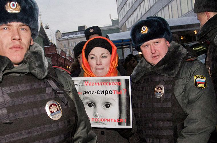 Police in Moscow detain a demonstrator who protests Russia's new ban on American adoptions.