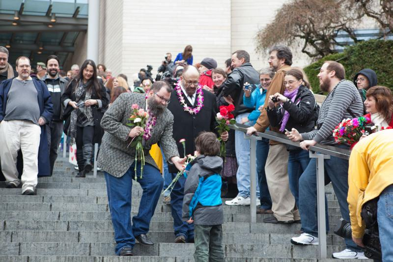 Well-wishers greet newly married couples as they make their way down the Grand Staircase outside of City Hall. Strangers give out flowers, toss rice and shout for the newlyweds to kiss.
