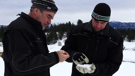 Idaho Power's Derek Blestrud and Brandal Glenn study the type of snow thats falling as a result of cloud seeding.