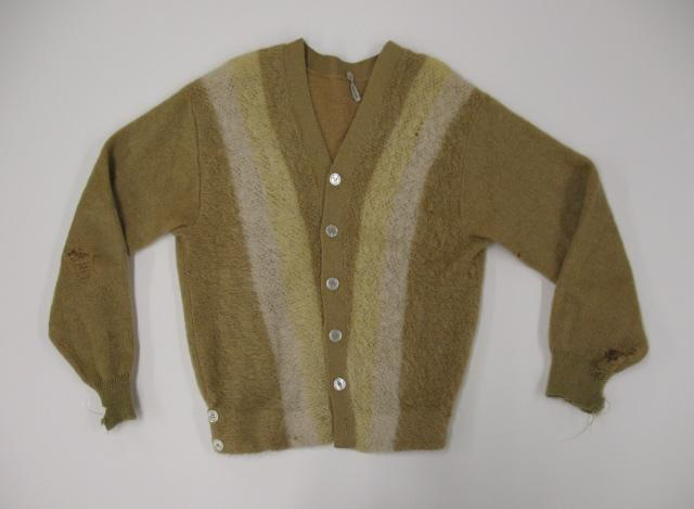 A cardigan worn by Kurt Cobain of Nirvana. The guys in the band dressed like their audience, making them more accessible than the rock gods of the past. The music and style of dress that became known as grunge defined Seattle to the rest of the world.