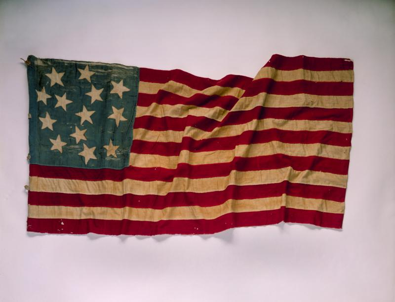 During the Treaty War of 1855-1856, many Seattle settlers fled for safety to Fort Decatur. This flag was sewn there by the women of Seattle and the countryside during the long, anxious days in the blockhouse, waiting for the siege to end.