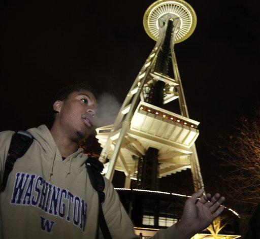 Andre Edwards smokes marijuana, Thursday, Dec. 6, 2012, just after midnight at the Space Needle in Seattle.