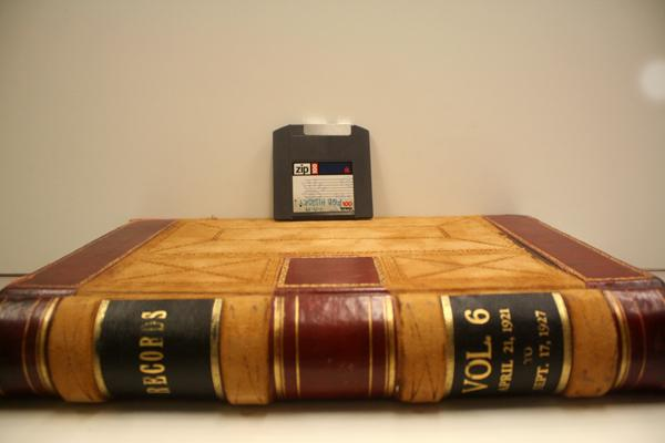 Information storage gets smaller: Bound book verses Zip drive. From the Special Collections Archive, Allen Library, UW.