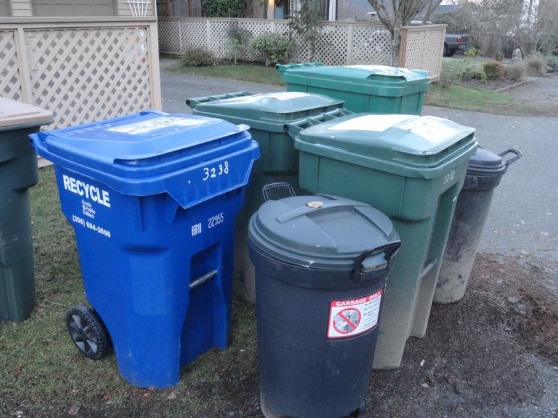 Photo of 5 garbage and recycling containers