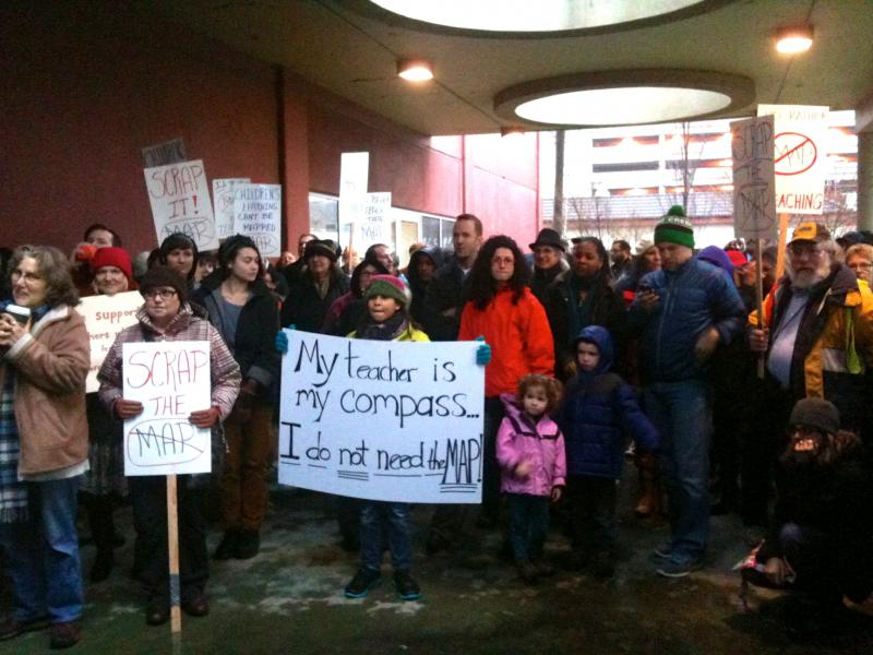 "Teachers, parents and students called for Seattle Public Schools to ""scrap the MAP"" at a rally outside district headquarters on Jan. 23, 2012."