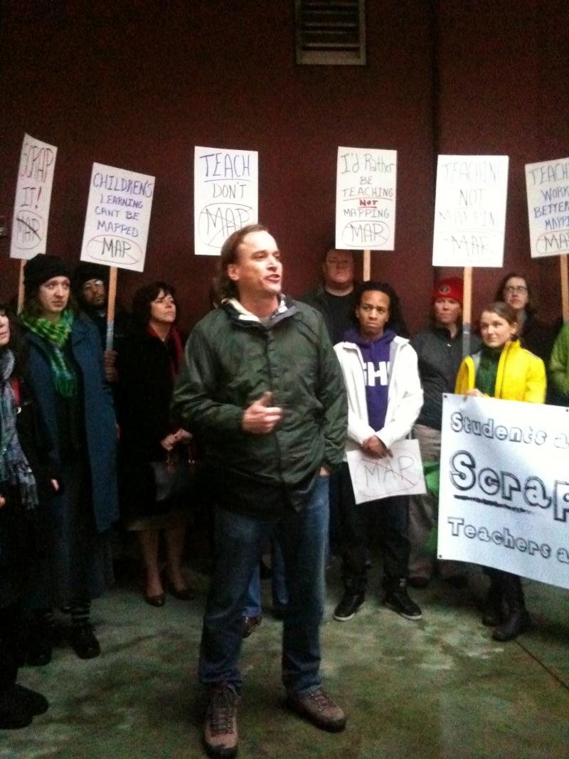 Orca K-8 teacher Matt Carter addresses the anti-MAP test rally outside Seattle School District headquarters on Jan. 23, 2012.