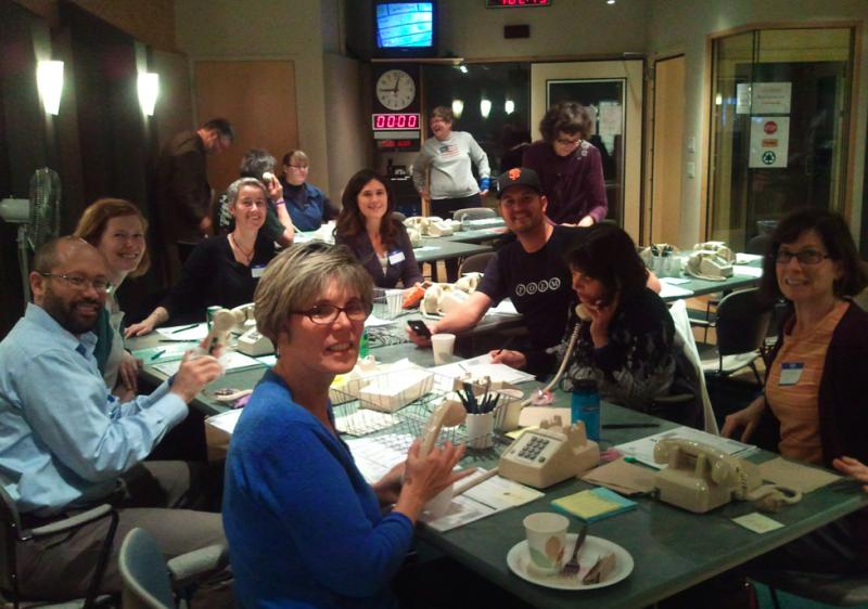 Volunteers from Group Health answer phones for a KUOW pledge drive.