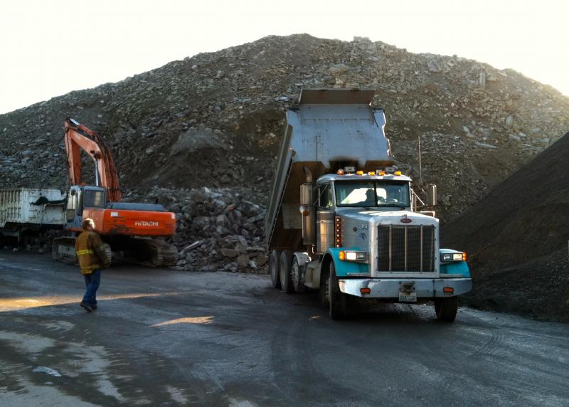 Dickie Allen supervises a truckload of concrete debris arriving at Contractors Concrete Recycling in Seattle