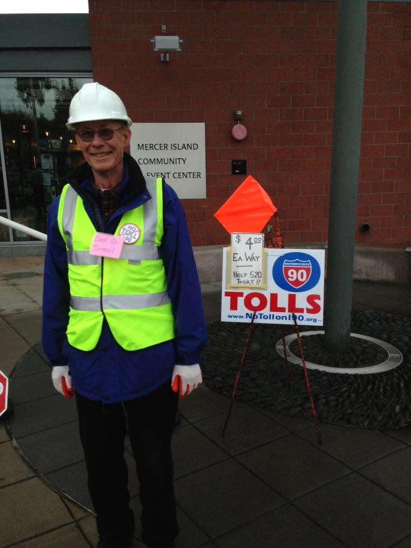Larry McWilliams protests I-90 tolls outside of the Mercer Island meeting