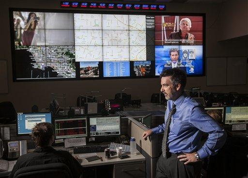 In this photo taken June 29, 2012, UCLA anthropology professor Jeff Brantingham displays computer generated predictive policing zones at the Los Angeles Police Department Unified Command Post.