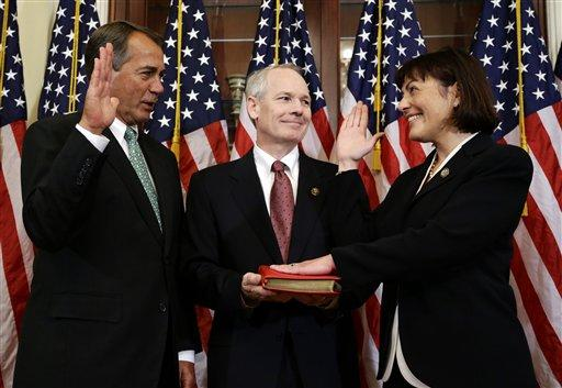 House Speaker John Boehner of Ohio, left, performs a mock swearing in for Rep. Suzan DelBene, D-Wash., right, with her husband Kurt DelBene, center, on Capitol Hill Tuesday, Nov. 13, 2012, in Washington.