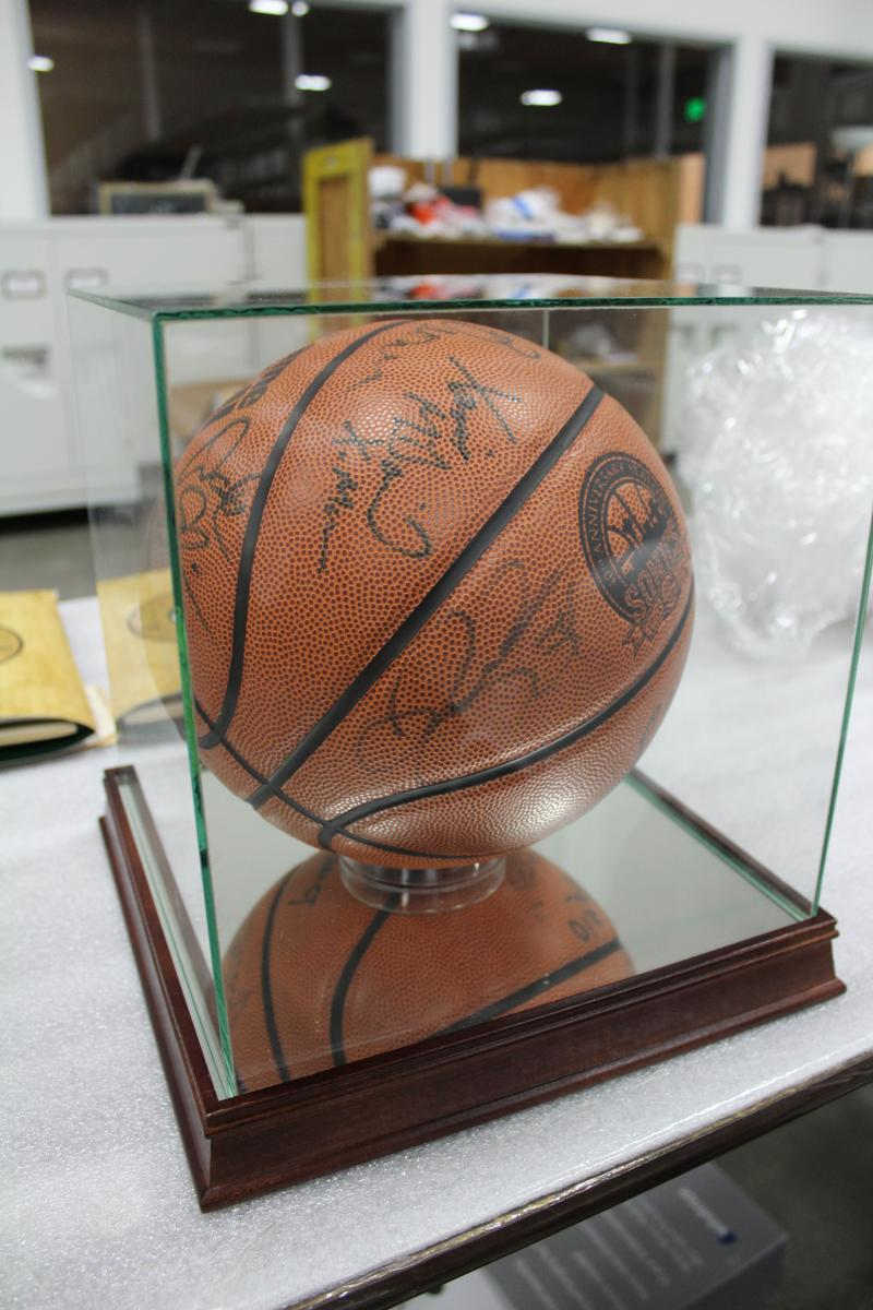 Commemorative basketball signed by Fred Brown, Xavier McDaniels, Dale Ellis, and others
