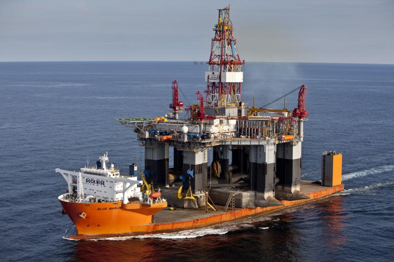 "Shell plans to haul its two disabled Arctic rigs to Asia for repairs on ""heavy-lift"" ships like the Blue Marlin, shown carrying an oil rig."