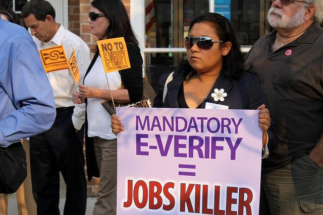 E-Verify protesters march in front of Congressman Peter King's office, Massapequa Park, New York, Sept. 2011.
