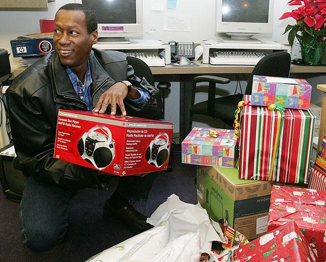 Robert Clark opens donated Christmas presents at the Innocence Project's offices in Atlanta in 2005. It's Clark's first Christmas in the free world since he was exonerated of a rape charge by DNA evidence and released from prison.