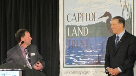 Governor Jay Inslee (right) joined Capitol Land Trust executive director Eric Erler at the conservation group's annual breakfast in Olympia.