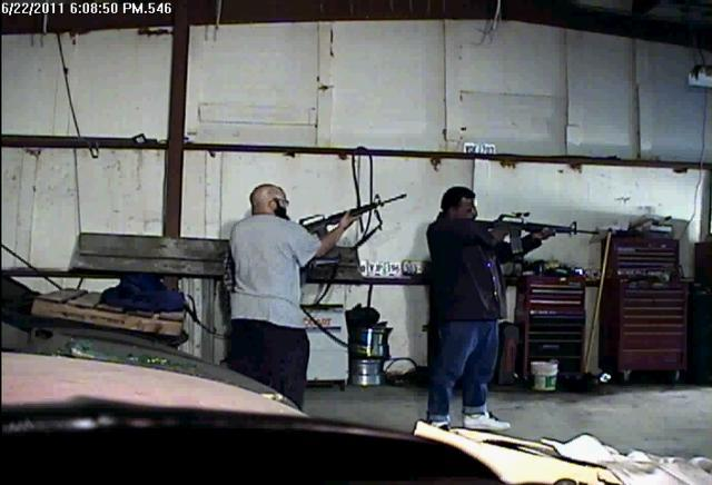 Abu Khalid Abdul-Latif (left) and Walli Mujahidh aim machine guns purchased from a police informant in 2011. Mujahidh is scheduled for sentencing on April 8.