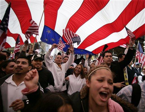 Demonstrators walking under a giant American flag march through downtown Chicago, Monday, May 1, 2006, to show support for immigrant rights.