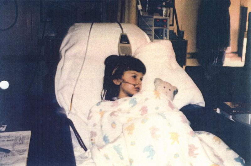 Allysa in the hospital getting dialysis.
