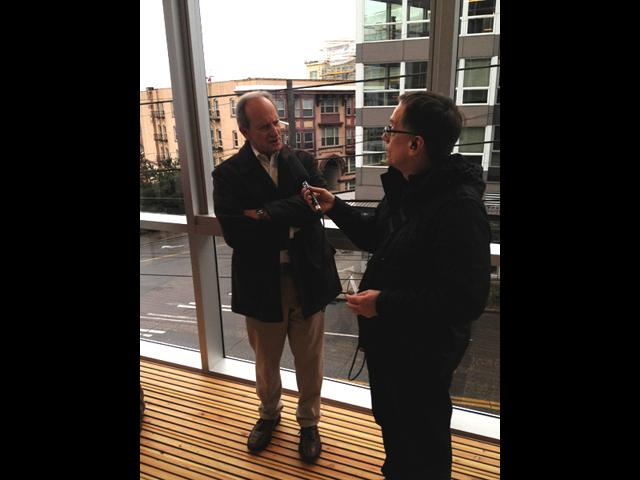 Ross Reynolds speaks with Denis Hayes, the president and CEO of the Bullitt Foundation, at the new Bullitt Center.