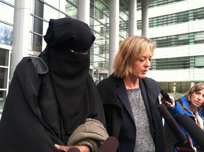 Abu Khalid Abdul-Latif's wife, Binta Moussa-Davis, and his attorney, Jennifer Wellman, on the federal courthouse steps after he was sentenced to 18 years for plotting to attack a military processing center.