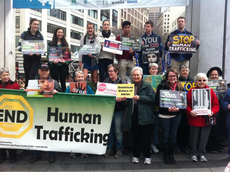 Human trafficking vigil at Westlake Center. Emily Kubota is in the top row, second from the left.