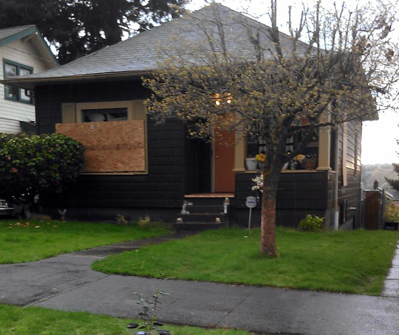 The house where Bellevue police shot and killed suspect Russell Smith is still boarded up. The neighborhood was locked down for four hours. Eventually, police stormed the house. No one else was inside.