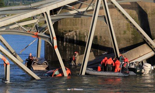 In this photo provided by Francisco Rodriguez, rescue boats approach victims at their vehicles in the Skagit River after the collapse of the I-5 bridge minutes earlier Thursday, May 23, in Mount Vernon, Wash.