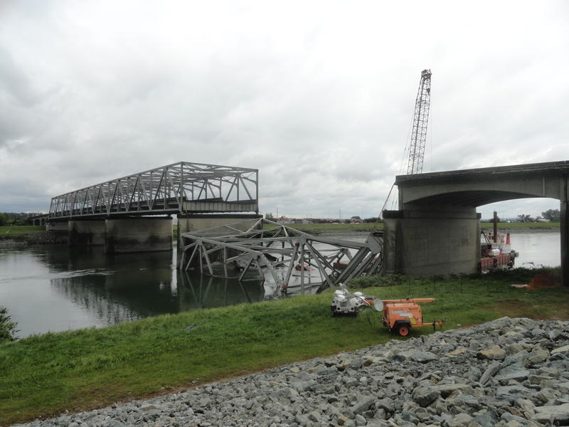The collapsed bridge section remained in the water on Sunday.