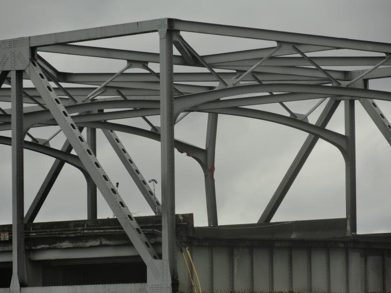 Other parts of the bridge that are still standing are visibly damaged.