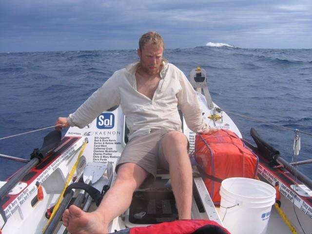 Fellow crewman Greg Spooner rests briefly about two weeks into the journey.