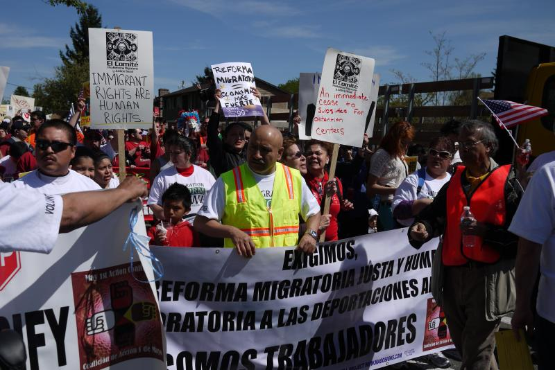 Immigrant rights supporters marching.