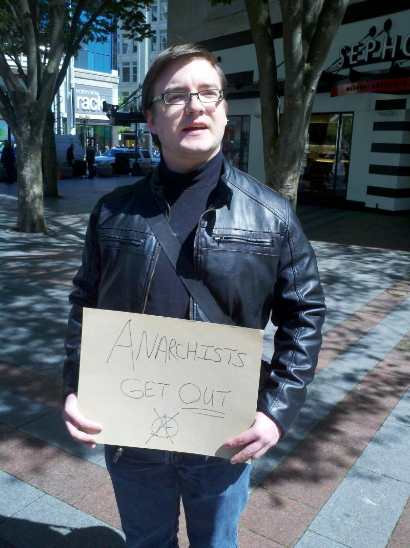 """I'm a coward,"" Eric said, but he mounted a one-man demonstration against so-called anarchists and property damage from May Day 2012."