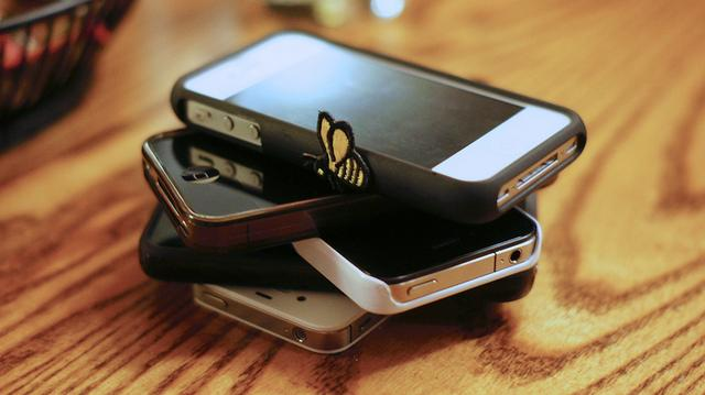 A rise in texting at dinner has given rise to a popular game: Participants place their phones in a stack in the middle of the table at a restaurant. The first person to cave in and answer a call or text pays for the rest of the table.