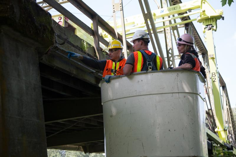 King County Executive Dow Constantine (left) accompanies inspectors during a recent review of the Alvord T. Bridge