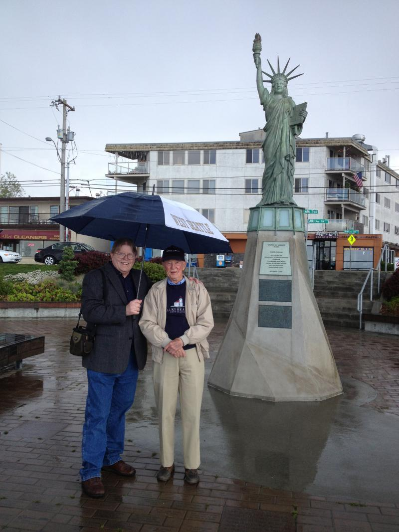West Seattle historian Clay Eals (left) stands with WW2 veteran and West Seattle resident John Kelly. John was a Boy Scout troop leader in 1952. He was present on the statue's dedication day.
