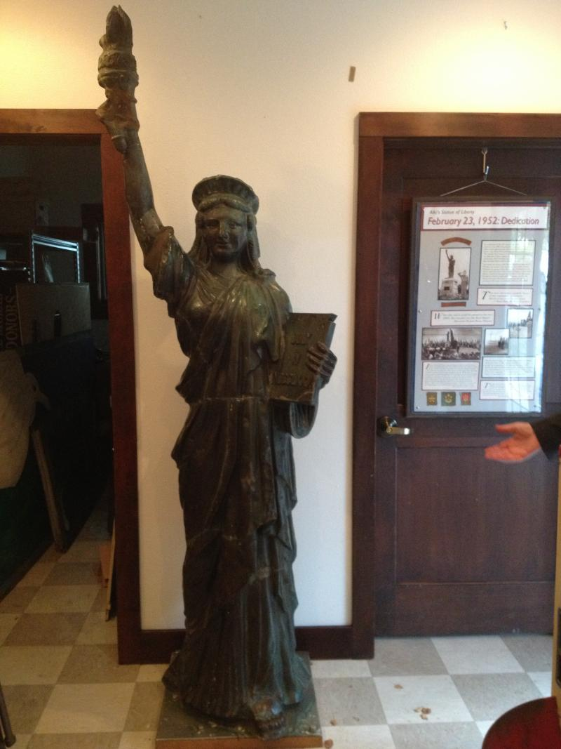 The statue was recast in bronze in 2007 after vandals tore the spikes off her crown and twisted off her arm (the arm's been patched). The original statue is stored in the Annex at the Southwest Seattle Loghouse Museum.