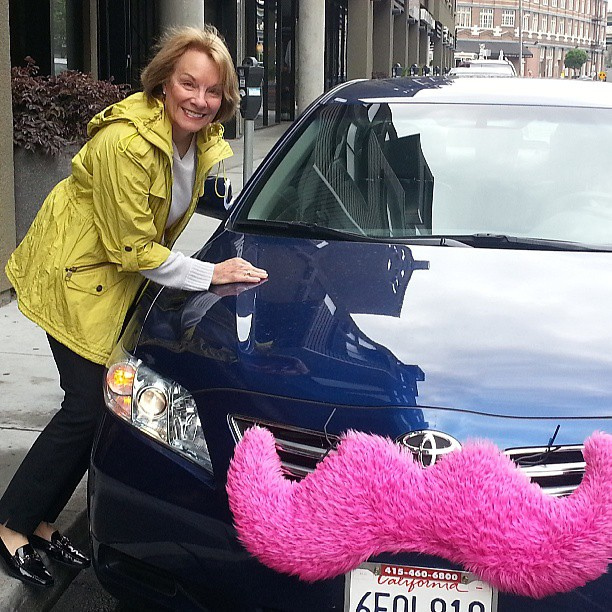 A Lyft car is always very recognizable by its bright pink mustache, but is that enought to compete with the traditional taxi service?